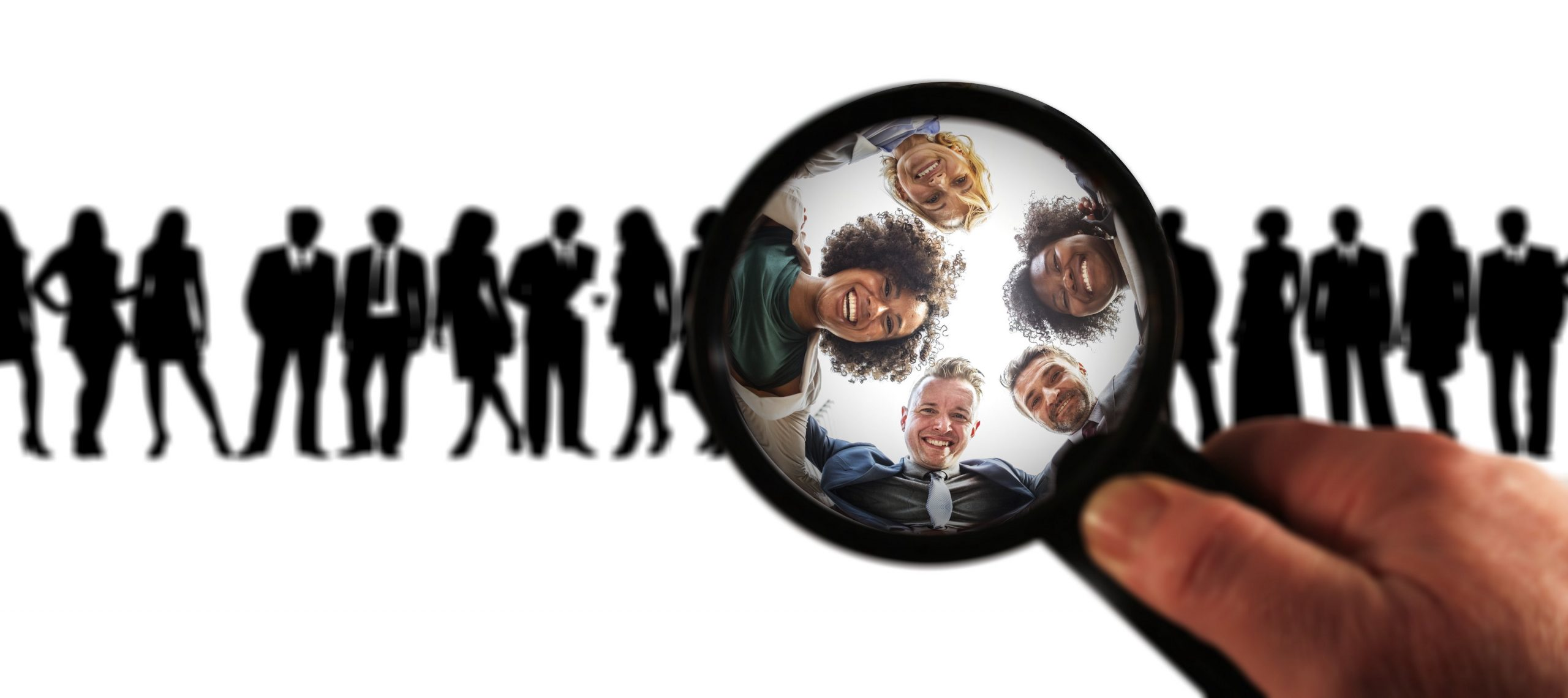 Magnifying glass focusing on faces in a research group